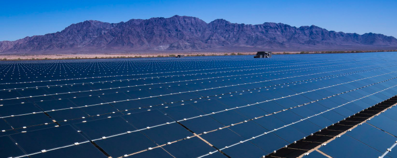 Solar Array by a desert mountain range